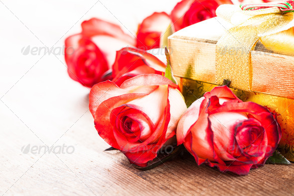 Gift box and bouquet of roses - Stock Photo - Images