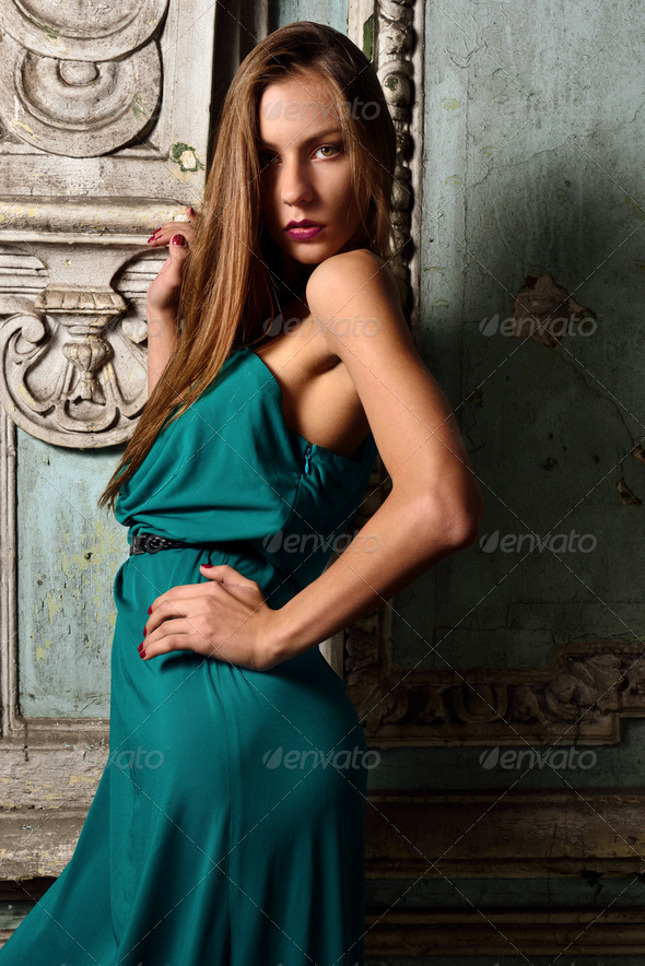 Sexy beautiful woman green gown in palace. - Stock Photo - Images