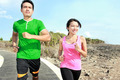 young couple jogging together on jogging track