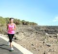 beautiful girl jogging on jogging track