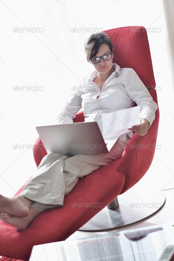 woman using a laptop computer at home - Stock Photo - Images