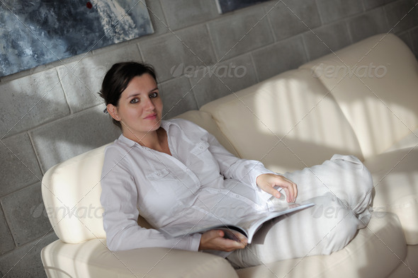 woman reading magazine at home - Stock Photo - Images