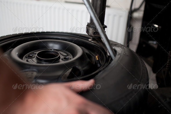 Tire change closeup - Stock Photo - Images