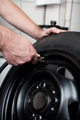 Mechanic filling air into a car tyre - PhotoDune Item for Sale