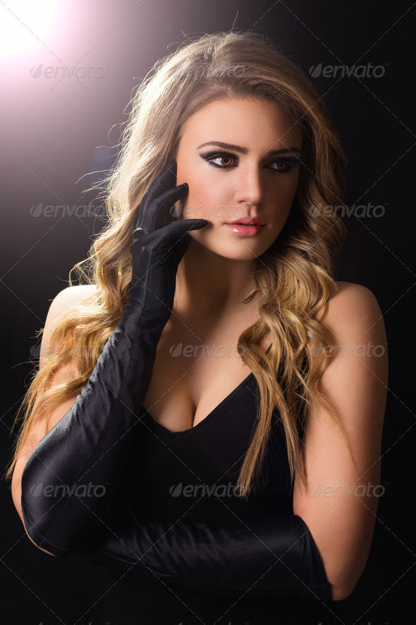 Glamorous young blonde woman in black - Stock Photo - Images