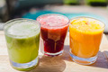 Yellow, green and red fruit and vegetable juices in tumbler glas - PhotoDune Item for Sale