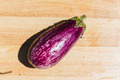 Eggplant on wooden chopping board - PhotoDune Item for Sale