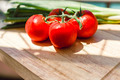 Fresh juicy tomatoes on wooden chopping board - PhotoDune Item for Sale