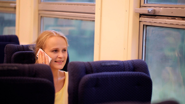 Woman Talking on the Phone Being on the Train