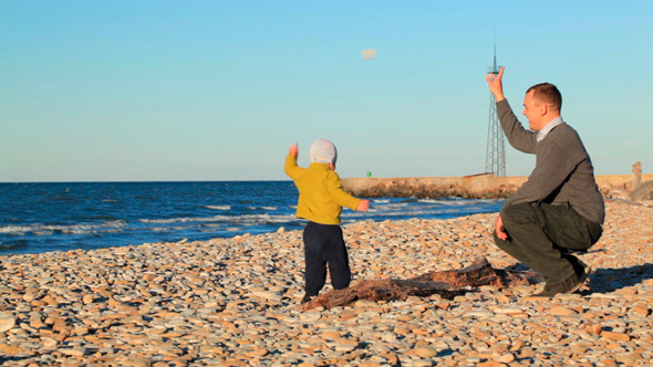 Father and Son Playing on Pebble Beach