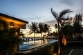 Sunset over  hotel pool. - PhotoDune Item for Sale