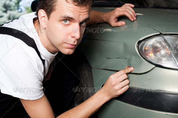 Close-up of damaged car  inspected by mechanic - Stock Photo - Images