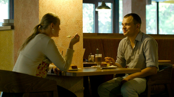 Young Couple in A Cafe