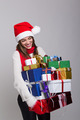 Happy young woman laughing carrying many presents - PhotoDune Item for Sale