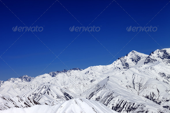 Winter snowy mountains and blue sky - Stock Photo - Images