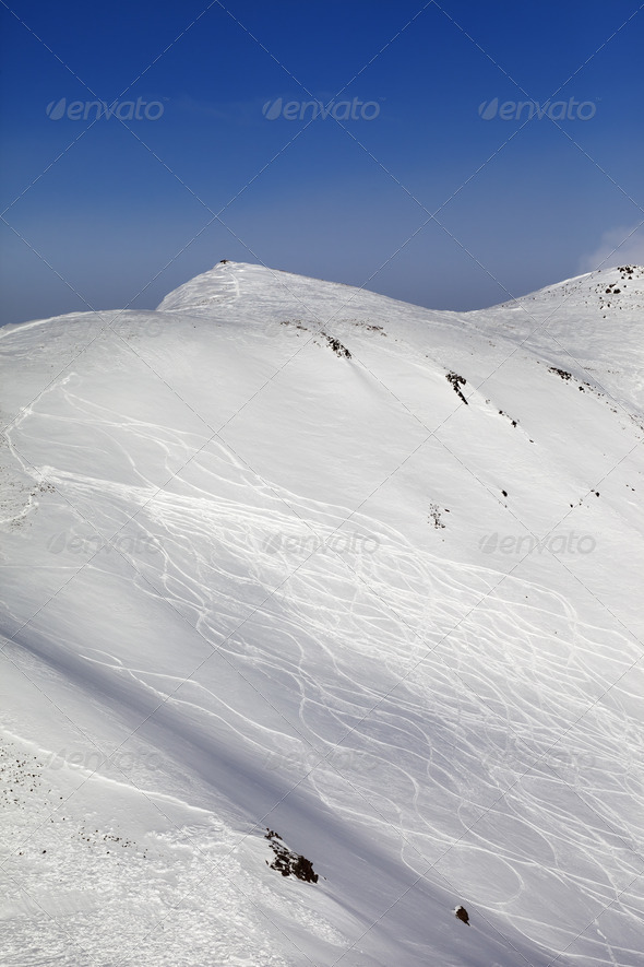 Off-piste ski slope with traces - Stock Photo - Images