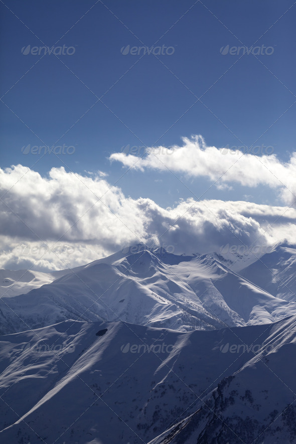 Snowy mountains at evening - Stock Photo - Images