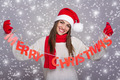 Happy Santa girl showing Merry Christmas sign - PhotoDune Item for Sale