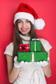 Excited teenage girl holding Christmas gift boxes - PhotoDune Item for Sale