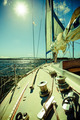 Seascape and sun on sky. View from yacht deck. Travel tourism.