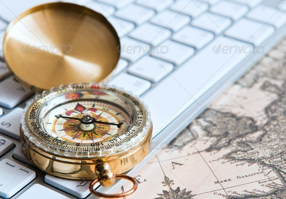Stock Photo - PhotoDune compass on the keyboard 672750