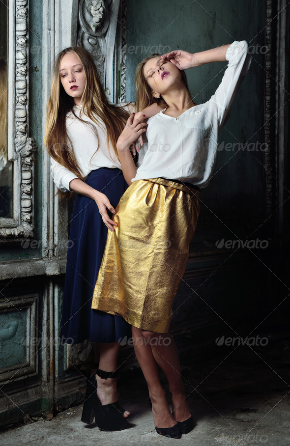 Two beautiful women posing in obsolete interior. - Stock Photo - Images