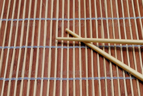 japanese chopsticks on bamboo placemat background - Stock Photo - Images