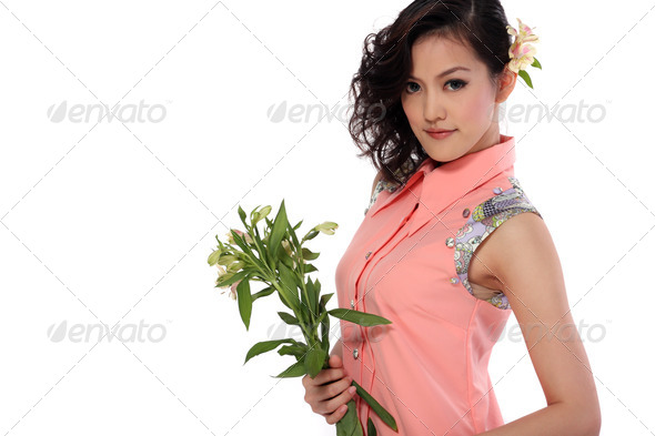 Young adult woman with flower - Stock Photo - Images
