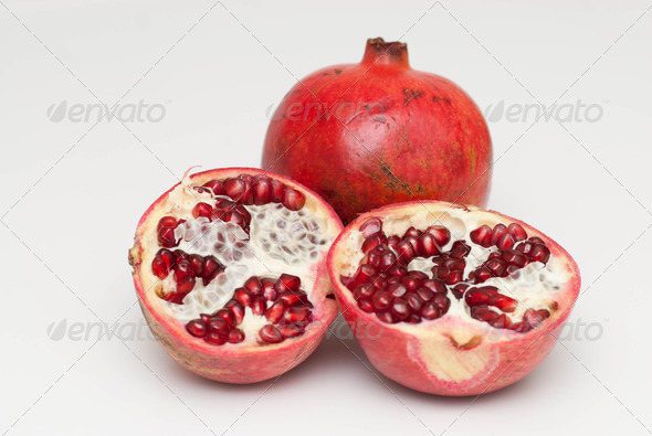 fresh cut pomegranate on a white background - Stock Photo - Images