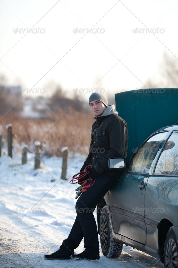 Man with broken car in winter - Stock Photo - Images