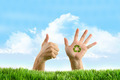 Hands with recycle sign in the grass - PhotoDune Item for Sale