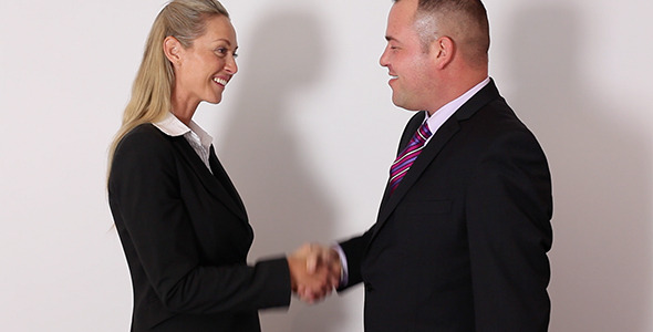 Business Man & Woman Shaking Hands