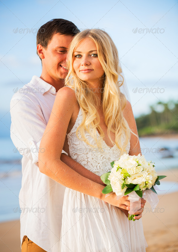 Married couple, bride and groom at sunset on beautiful tropical - Stock Photo - Images