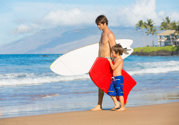 Father and Son Going Surfing Together on Tropical Beach in Hawai - Stock Photo - Images