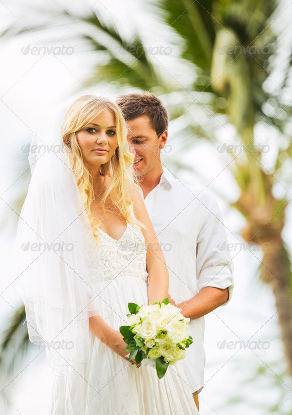 Married couple, bride and groom getting married, Tropical weddin - Stock Photo - Images