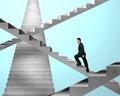Businessman walking on maze stairs