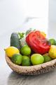 vegetables inside cork basket in kitchen counter - PhotoDune Item for Sale