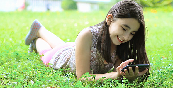 Girl Playing Outdoor with Her Smart Phone