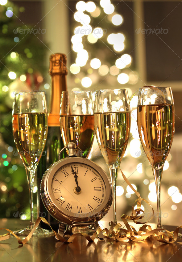 Four glasses of champagne ready for the New Year - Stock Photo - Images