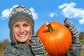 Young woman holding up a  pumpkin - PhotoDune Item for Sale