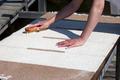Scrubbing carpet on the dock - PhotoDune Item for Sale
