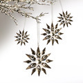 Silver snowflakes hanging against pale grey - PhotoDune Item for Sale