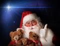 Santa smiling holding toy teddy bears - PhotoDune Item for Sale