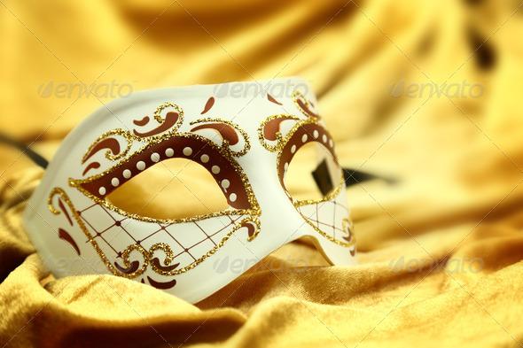 Vintage venetian carnival mask on velvet background
