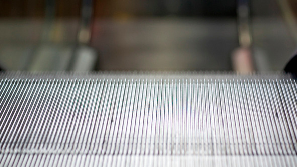 Escalator Running Down