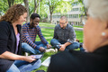 Group Of Students Using Digital Tablet On Campus - PhotoDune Item for Sale