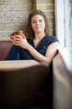 Woman Holding Coffee Cup In Cafeteria - PhotoDune Item for Sale