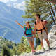 Couple is doing trekking in the mountains - PhotoDune Item for Sale