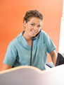 Nurse Answering Telephone While Working At Reception - PhotoDune Item for Sale