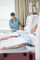 Nurse Looking At Patient Undergoing Renal Dialysis - PhotoDune Item for Sale